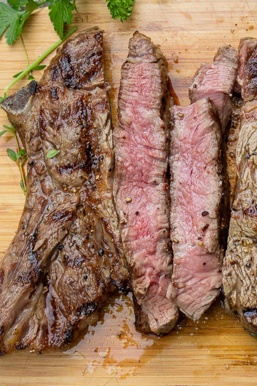sliced grilled rib steak on cutting board p2