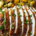 sous vide turkey breast sliced on plate with stuffing p4