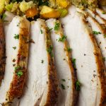 sous vide turkey breast sliced on plate with stuffing p3