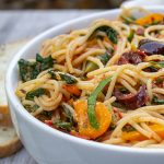 Mediterranean Pasta in bowl with bread beside it