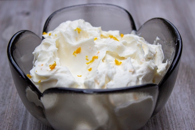 whipped cream in a bowl with orange zest