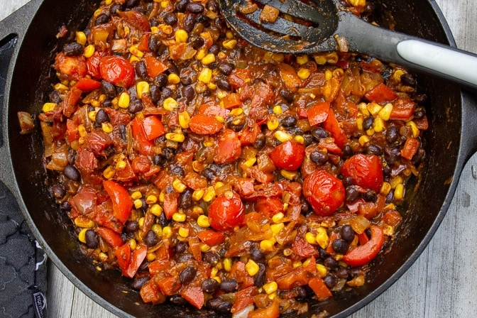 sauce with Mexican ingredients in skillet