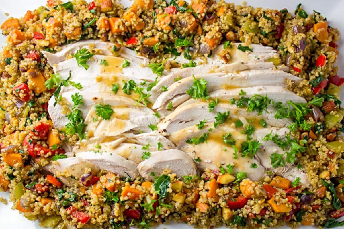 quinoa stuffing around sliced turkey on platter
