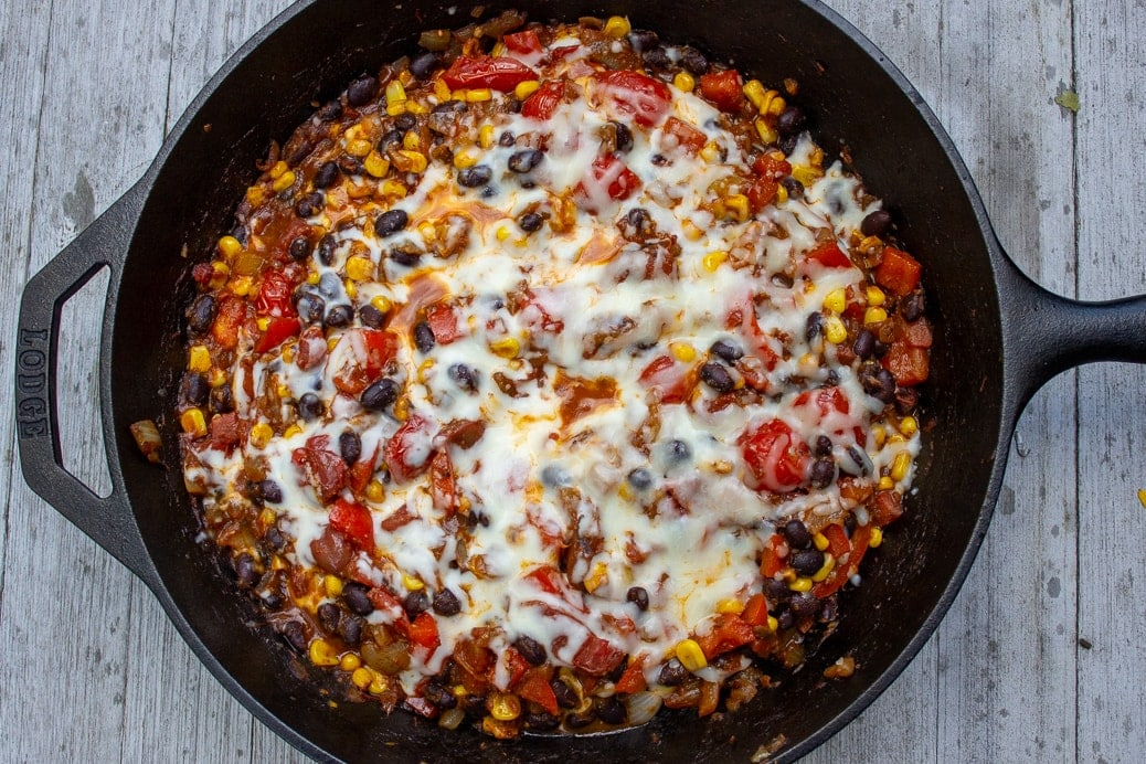 Mexican Spaghetti Squash with melted cheese in skillet