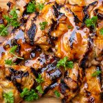 Grilled BBQ Chicken boneless thighs on cutting board p3