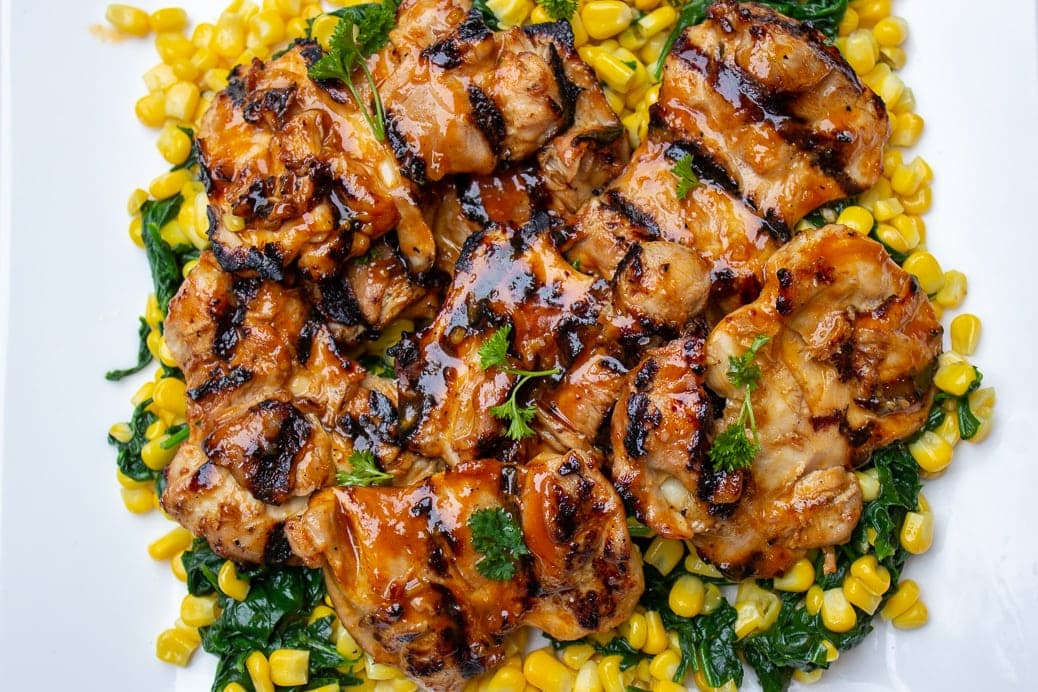 Grilled BBQ Chicken on bed of corn and spinach