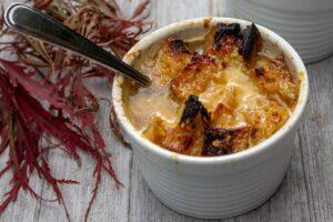 onion soup in bowl on wood board