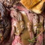 prime rib roast reverse sear on plate with gravy and yorkshire pudding p