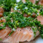 Slow Roasted Salmon With Gremolata close up cut up on plate