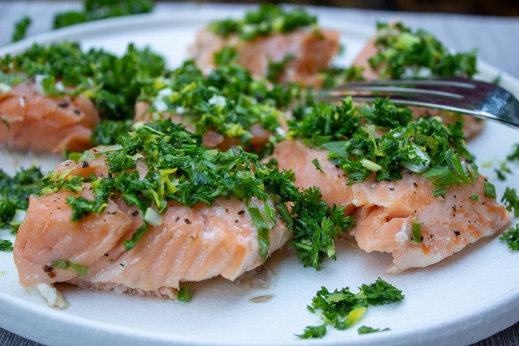 Slow Roasted Salmon With Gremolata cut up on plate