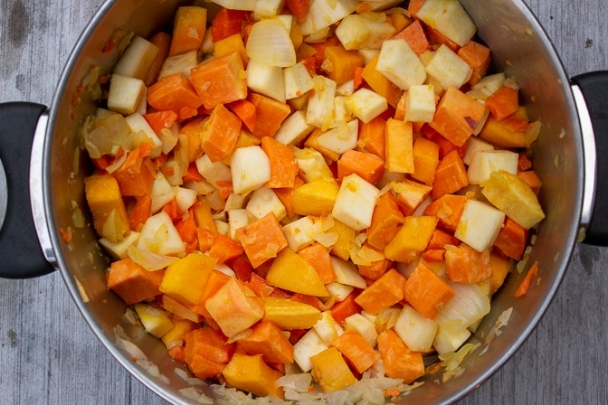 diced root vegetables in a pot