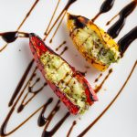 2 Stuffed Mini Peppers on plate drizzled with balsamic reduction p