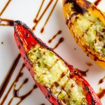 close up of 2 stuffed mini peppers with goat cheese