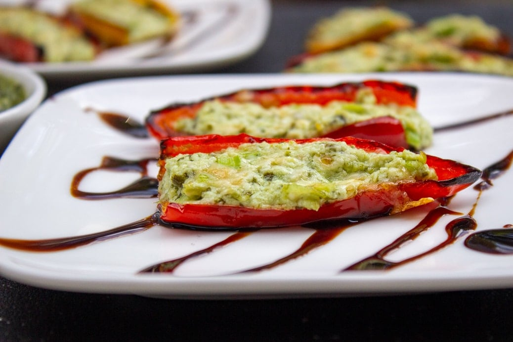Stuffed Mini Peppers With Goat Cheese on plate drizzled with balsamic reduction 3