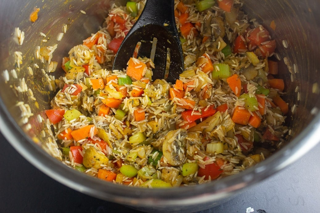sauteed veggies and raw rice in instant pot