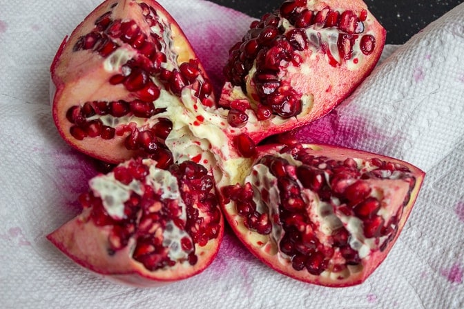 pomegranate split open into 4 parts