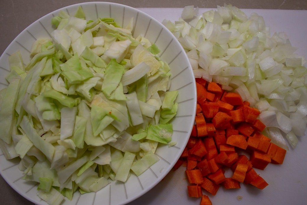 cut up cabbage carrots onions