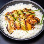 chicken bulgogi over rice on plate f