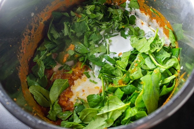 Curried Lentil Soup in instant pot finished cooking with coconut milk cilantro and spinach added but not yet stirred in