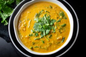 Curried Lentil Soup in bowl garnished with cilantro