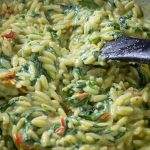 Parmesan Orzo with spinach in a skillet p
