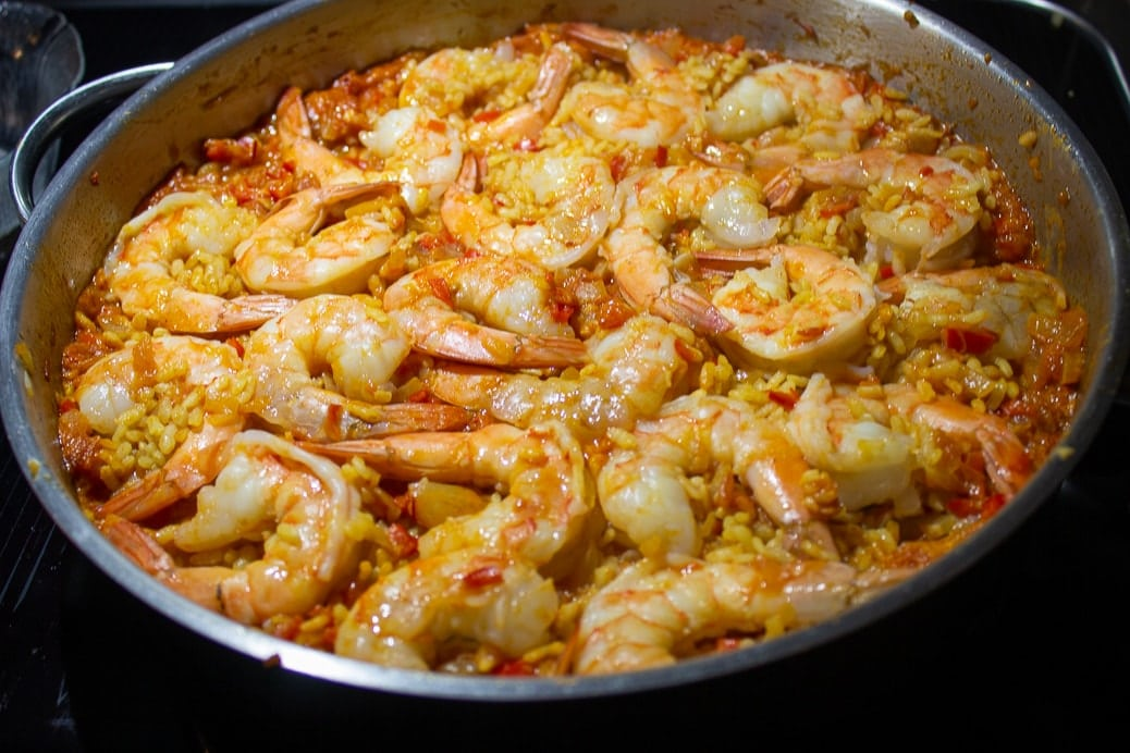 paella in large pan with shrimp laying on top just cooked 1