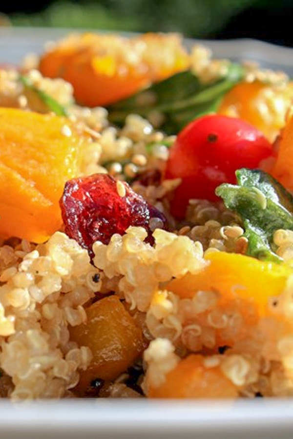 close up of quinoa and butternut squash salad in a serving bowl p2
