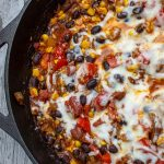 mexican topping with cheese in skillet p