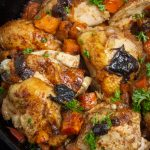 Moroccan chicken in skillet with sweet potatoes prunes onions p