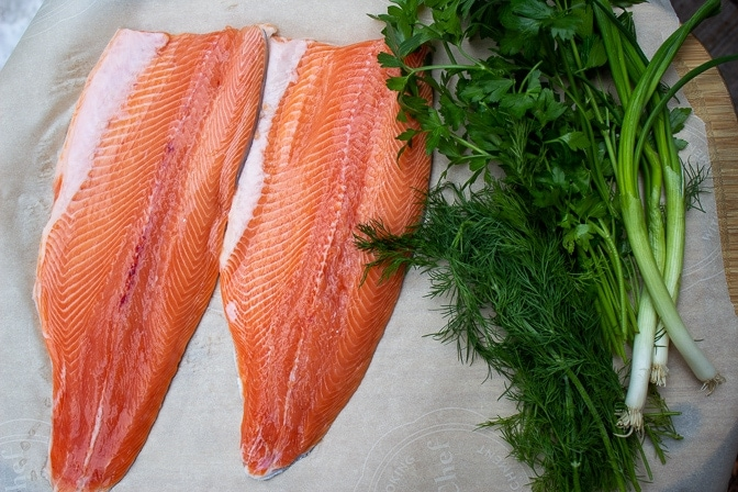 2 large trout fillets, dill, green onions, parsley, lemon, oil