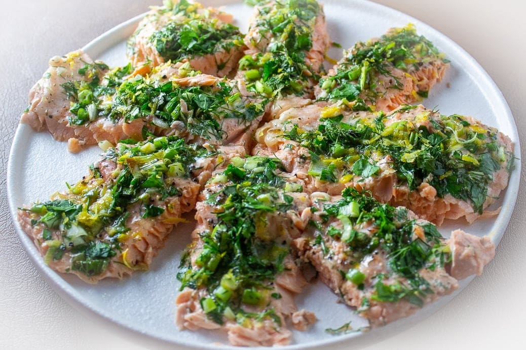 Lemon Herb Baked Trout pieces arranged on round plate
