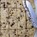 cooled chocolate chip cookie bars cut into squares in pan p