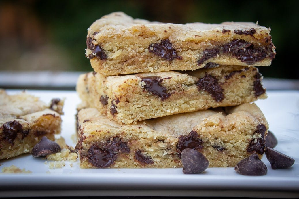 three chocolate chip cookie bars stacked on a plate
