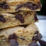 three chocolate chip cookie bars stacked on a plate p3