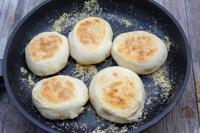 5 english muffins in a pan fully cooked