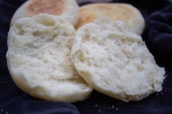 two halves of an english muffin showing fluffy inside