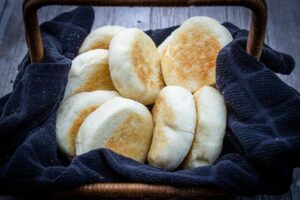 10 English muffins in a basket