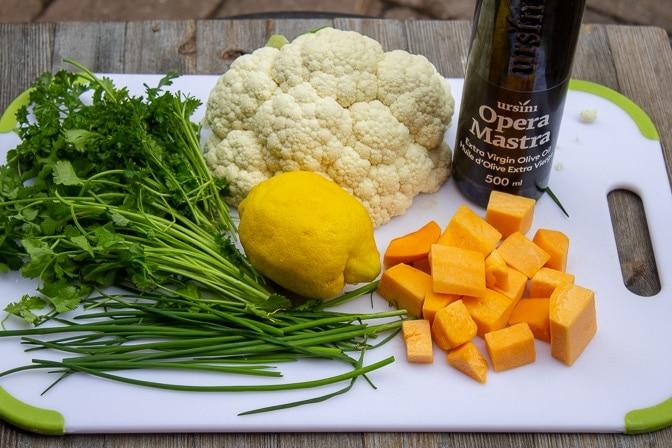 various herbs, lemon cauliflower cut up squash oil