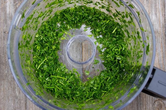 chopped herbs in processor