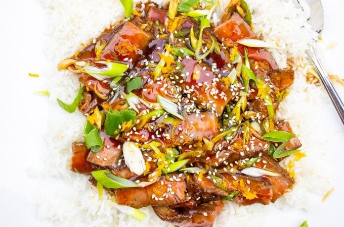 mongolian beef over rice on plate f