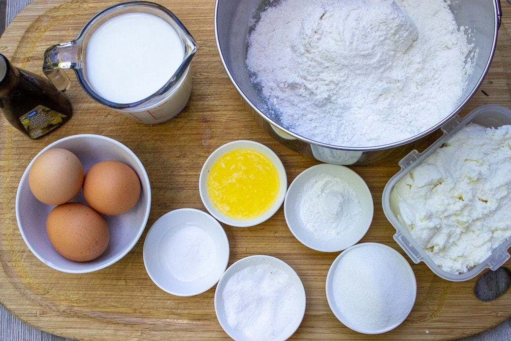 flour, sugar, ricotta, eggs, butter, baking powder, baking soda, salt, milk, vanilla