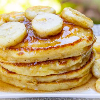 stack of ricotta pancakes with caramelized bananas on plate