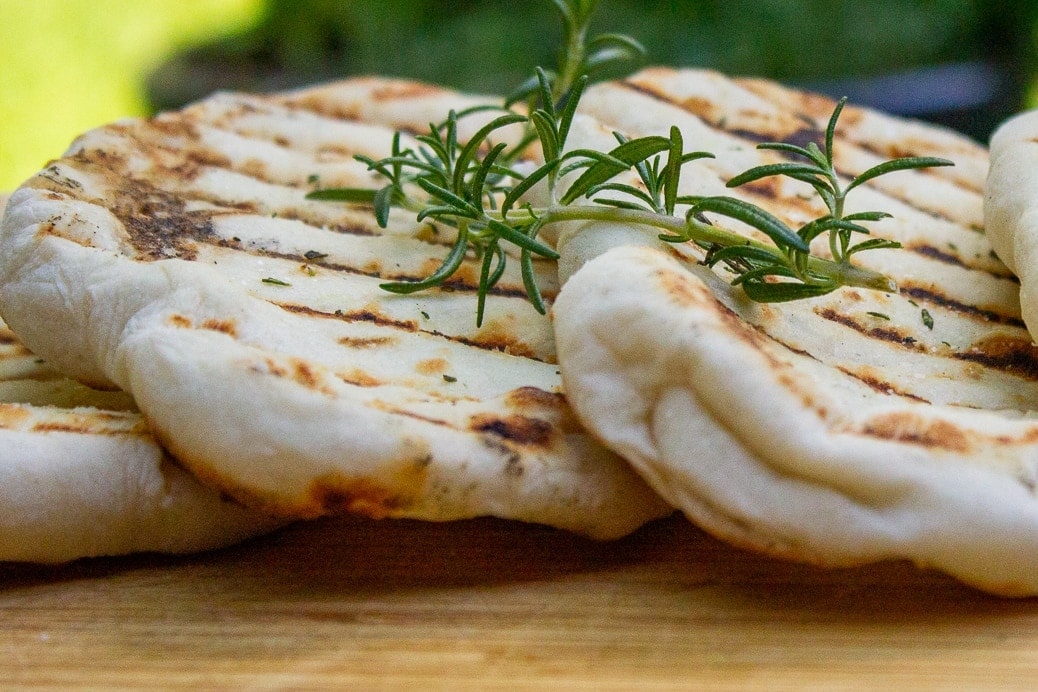 close up of naan on cutting board
