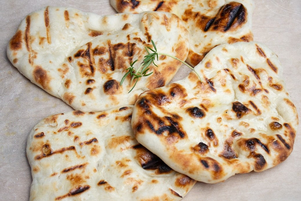 pieces of naan on cutting board