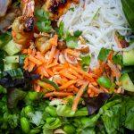 bowl with noodles, veggies, shrimp, garnish on mat p3