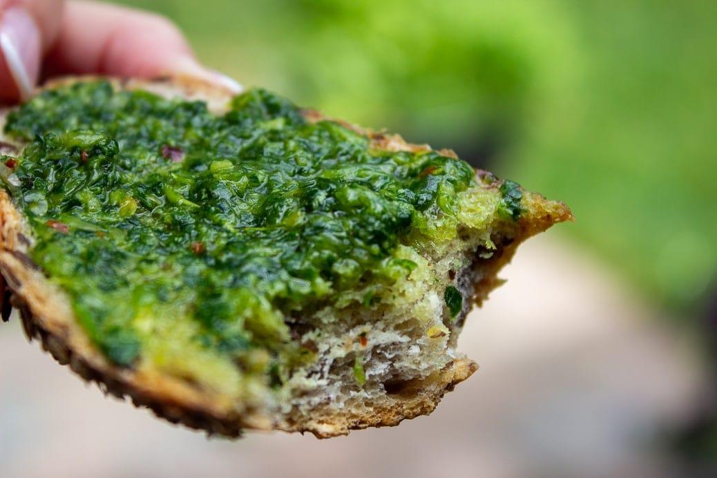 herb sauce spread on bread