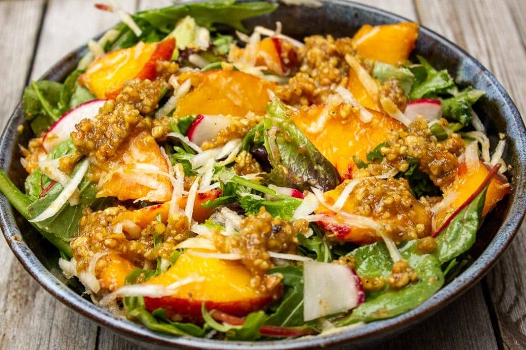 peach salad with walnut dressing in a bowl f