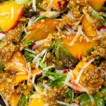 peach salad with walnut dressing in a bowl p