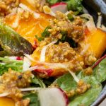 peach salad with walnut dressing in a bowl p1