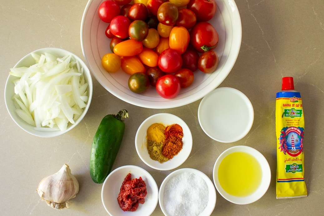 cherry tomatoes, sliced onions, jalapeno, garlic, tomato paste, salt, oil, water, seasonings, harrissa paste